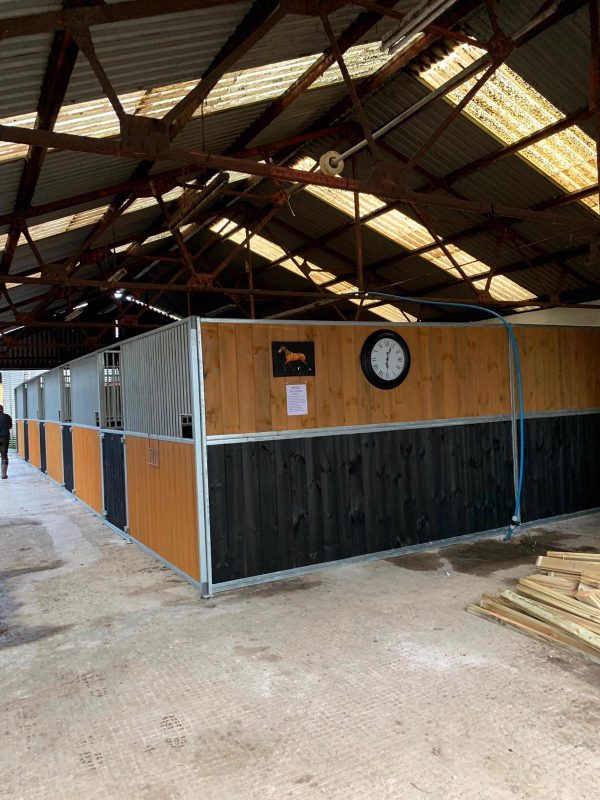Internal Horse Stables with clock
