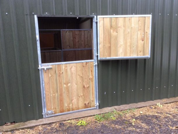 full board horse stable door in barn half open