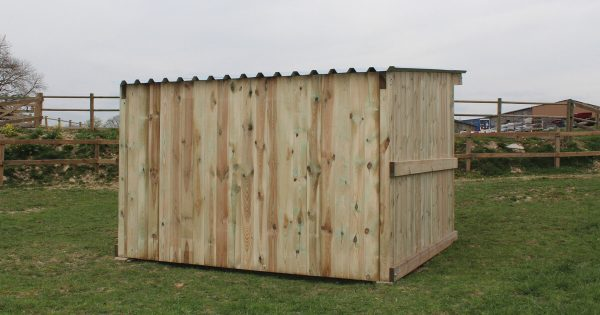 small timber field shelter view from behind