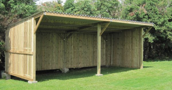 Large timber field shelter on grass