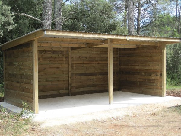 Timber field shelter by trees